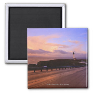 A Road & A Lighthouse Along The Coast At Sunset Square Magnet