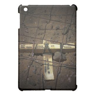 A road repair crew places a cross cover for the iPad mini