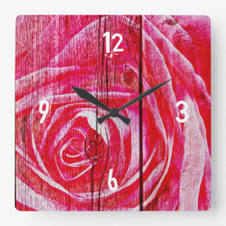 A rose image on a grungy wood panel wall clocks