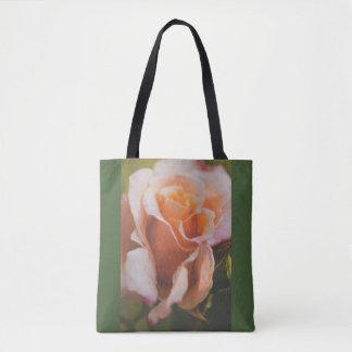 A rose under the rain tote bag