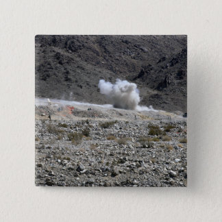 A round from an AT-4 small rocket launcher 15 Cm Square Badge