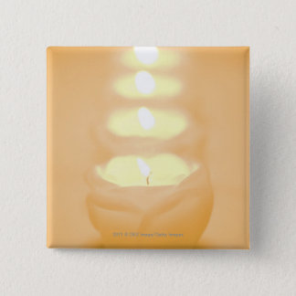 A row of lit candles 15 cm square badge