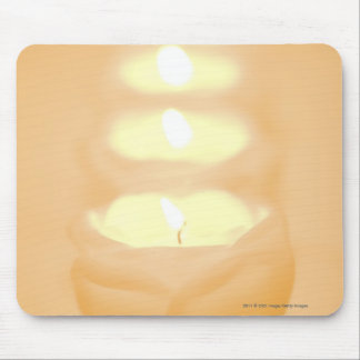 A row of lit candles mouse mat