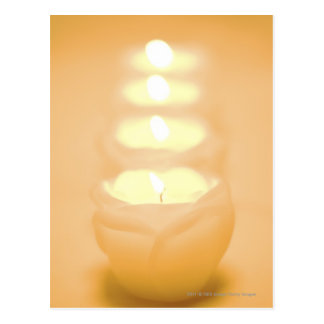 A row of lit candles postcard