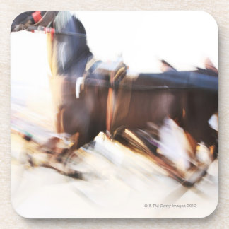 A running horse at a high speed is competing in drink coasters