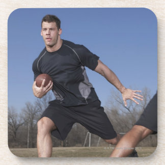 A running play during a touch football game. beverage coaster