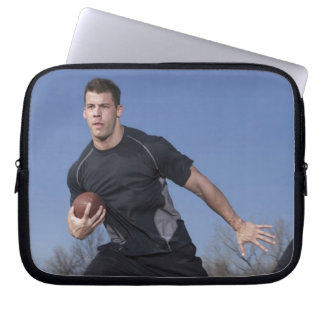 A running play during a touch football game. computer sleeve