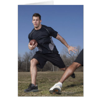 A running play during a touch football game. greeting card