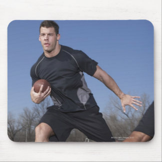 A running play during a touch football game. mouse pad
