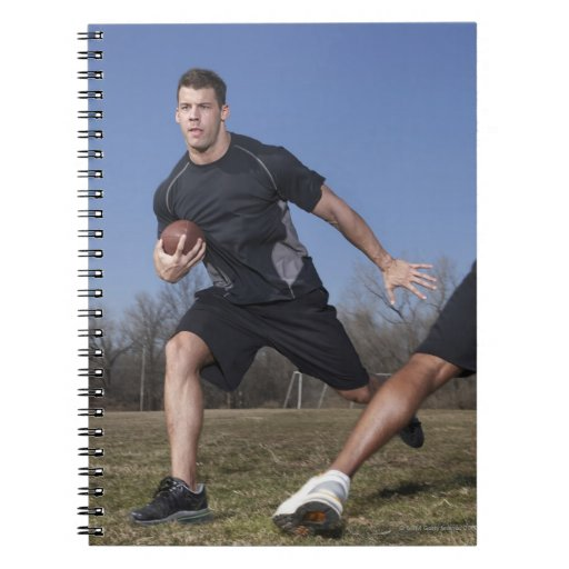 A running play during a touch football game. spiral notebook