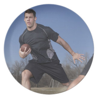 A running play during a touch football game. plates