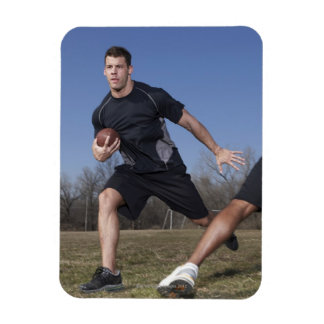 A running play during a touch football game. rectangular photo magnet