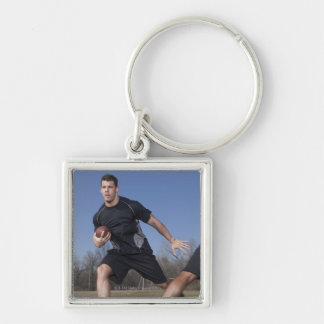 A running play during a touch football game. Silver-Colored square key ring