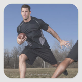 A running play during a touch football game. square sticker