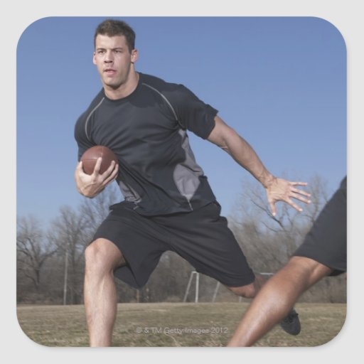 A running play during a touch football game. square stickers