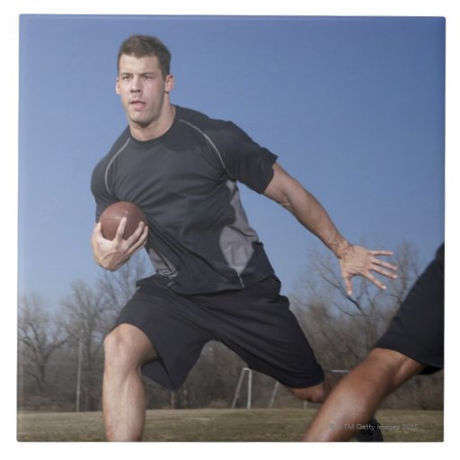 A running play during a touch football game. ceramic tiles