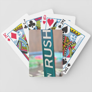 A Rush Street street sign in front of a neon Bicycle Playing Cards