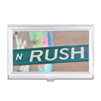 A Rush Street street sign in front of a neon Business Card Holder