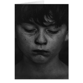A sad and teary boy blank card