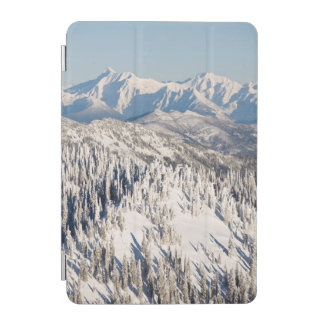 A Scenic View of Snowy Mountains and Trees. iPad Mini Cover