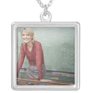 A school teacher silver plated necklace