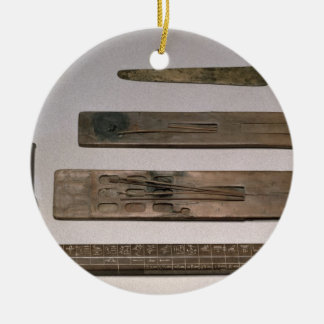 A scribe's instruments (wood, ivory, bronze and en christmas ornament