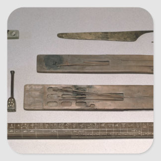 A scribe's instruments (wood, ivory, bronze and en square sticker