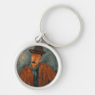 A seated man leaning on a table key ring