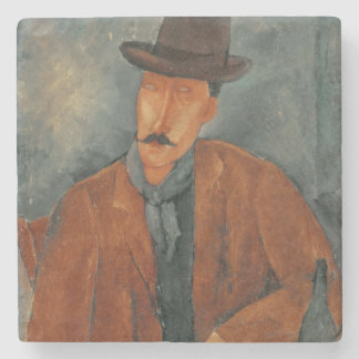 A seated man leaning on a table stone coaster