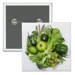 A selection of green fruits & vegetables. badges