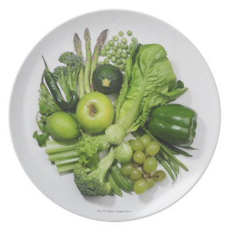 A selection of green fruits & vegetables. plate