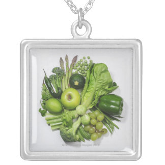 A selection of green fruits & vegetables. silver plated necklace