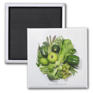 A selection of green fruits & vegetables. square magnet