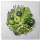 A selection of green fruits & vegetables. tile