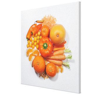 A selection of orange fruits & vegetables. canvas print