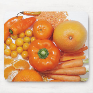 A selection of orange fruits & vegetables. mouse mat