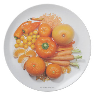 A selection of orange fruits & vegetables. plate