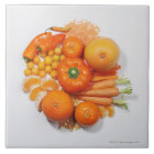 A selection of orange fruits & vegetables. tile