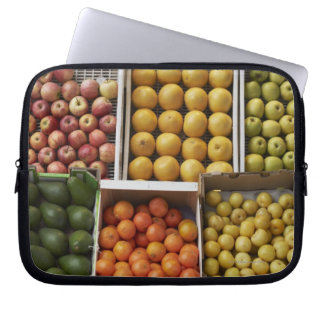 A selection of organic boxed fruit on laptop sleeve