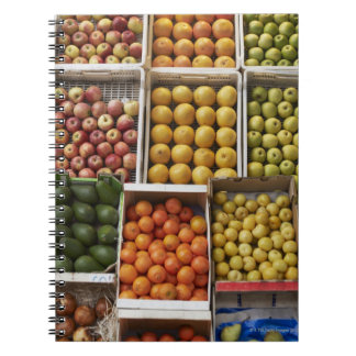 A selection of organic boxed fruit on notebook