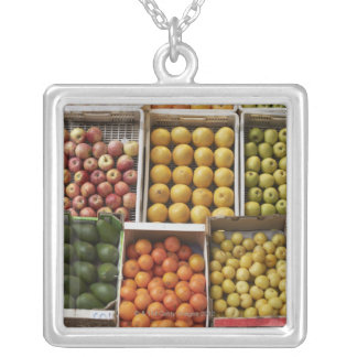 A selection of organic boxed fruit on silver plated necklace