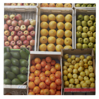 A selection of organic boxed fruit on tile