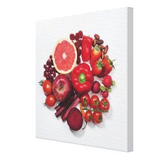 A selection of red fruits & vegetables. stretched canvas print