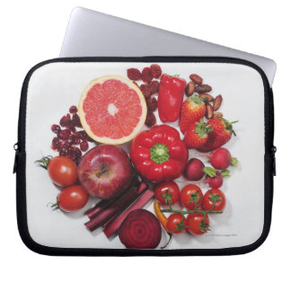 A selection of red fruits & vegetables. laptop sleeve