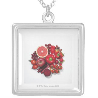 A selection of red fruits & vegetables. silver plated necklace