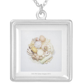 A selection of white fruits & vegetables. silver plated necklace