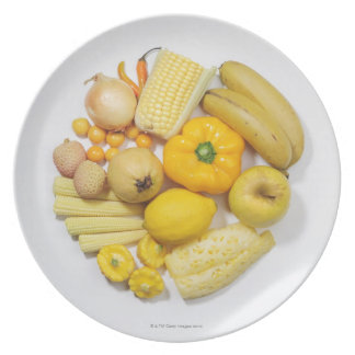 A selection of yellow fruits & vegetables. plate
