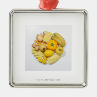 A selection of yellow fruits & vegetables. Silver-Colored square decoration