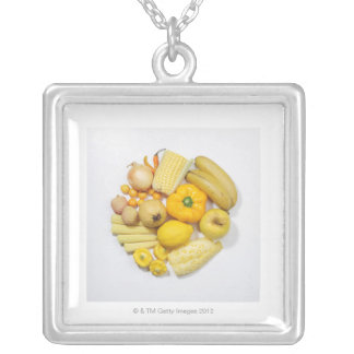 A selection of yellow fruits & vegetables. silver plated necklace