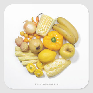 A selection of yellow fruits & vegetables. square sticker